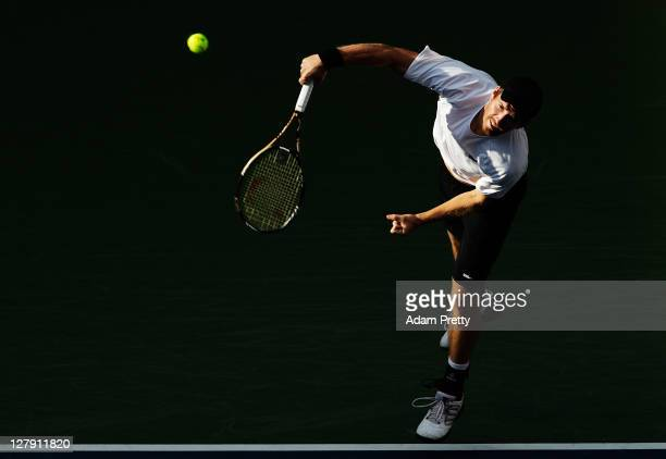 Alexander Peya of Austria serves during his first round doubles match against Tatsuma Ito and Kei Nishikori of Japan during day one of the Rakuten...