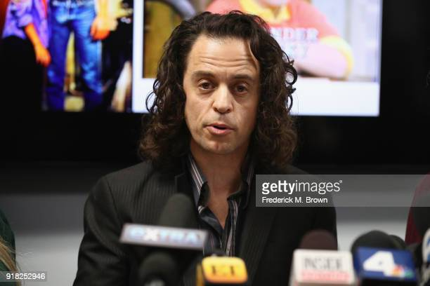 Alexander Polinsky speaks during a press conference with his attorney Lisa Bloom regarding sexual harassment allegations against Scott Baio at The...