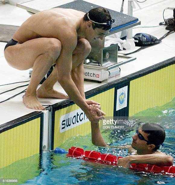 Alexander Popov congratulates his teammate Denis Pimankov after the men's 4x100 relay at the Goodwill Games in Uniondale NY 02 Aug Russia won with a...