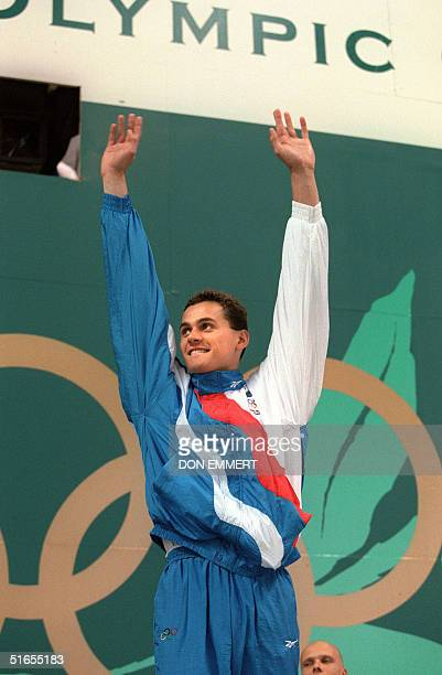 Alexander Popov from Russia celebrates his gold medal win in the Men's 50m freestyle event Atlanta 25 July 1996 Popov clocked a time of 2213 seconds