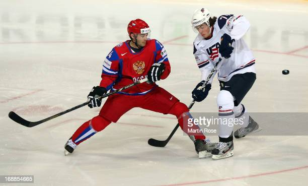 Alexander Popov of Russia and TJ Oshie of USA battle for the puck during the IIHF World Championship quarterfinal match between Russia and USA at...