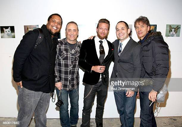 Alexander Porter Mike Pont Jamie McCarthy Mike Coppola and John Lamparski attend a pet portrait exhibition by Getty Images staff photographer Jamie...