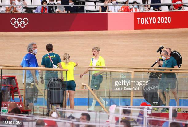 Alexander Porter of Team Australia after his fall is attended by its staff during the Men´s team pursuit qualifying of the Track Cycling on day 10 of...