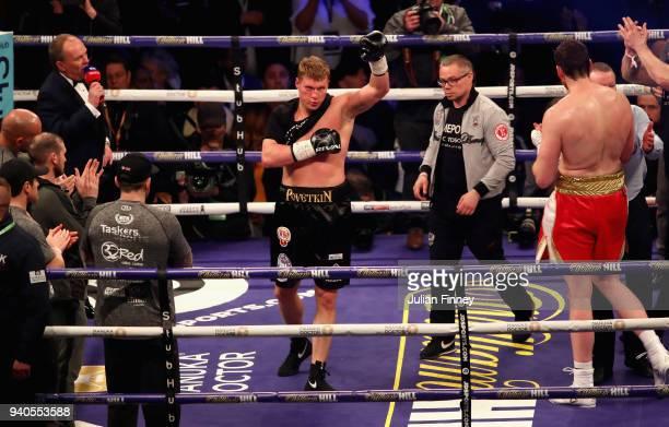 Alexander Povetkin celebrates victory over David Price after there WBA InterContinental Heavyweight WBO International Heavyweight Championship title...