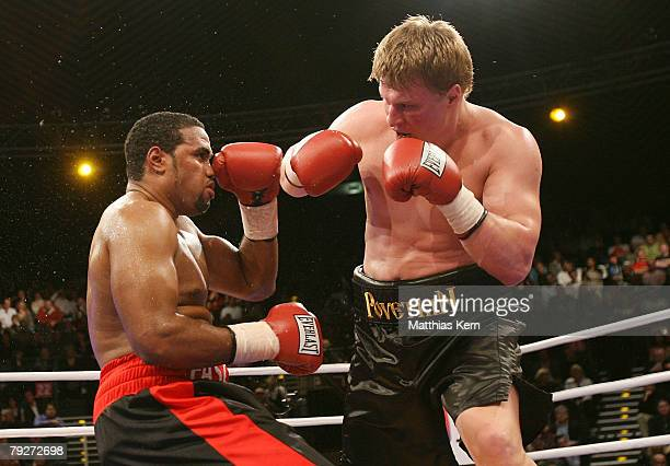 Alexander Povetkin of Russia fights Eddie Chambers of the US during their IBF final eliminator heavyweight match at the Tempodrom on January 26 2008...