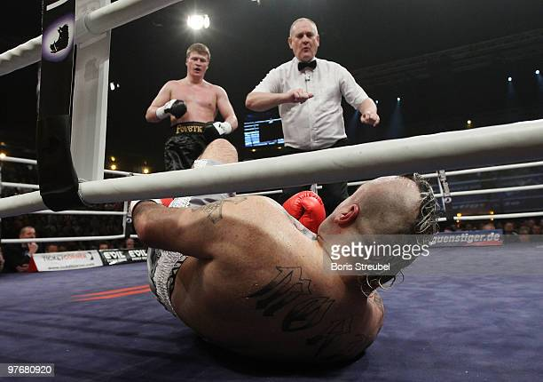 Alexander Povetkin of Russia knocks out Javier Mora of Mexico during their Heavyweight fight at the MaxSchmelingHalle on March 13 2010 in Berlin...