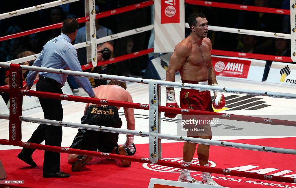 Alexander Povetkin of Russia lies on the floor during the 3rd round during their WBO, WBA, IBF and IBO heavy weight title fight between Wladimir Klitschko and Alexander Povetkin of Russia at Olimpiyskiy Arena on October 5, 2013 in Moscow, Russia.