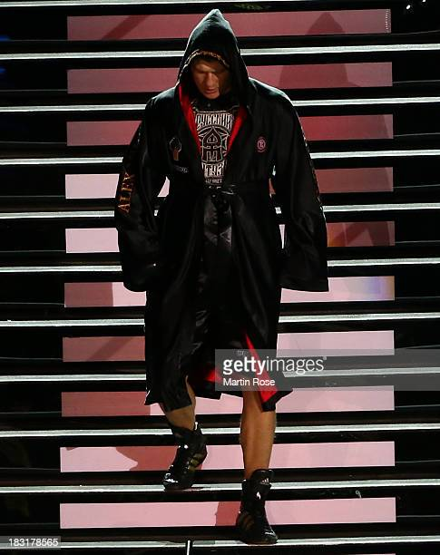 Alexander Povetkin of Russia walks to the ring before their WBO WBA IBF and IBO heavy weight title fight between Wladimir Klitschko and Alexander...
