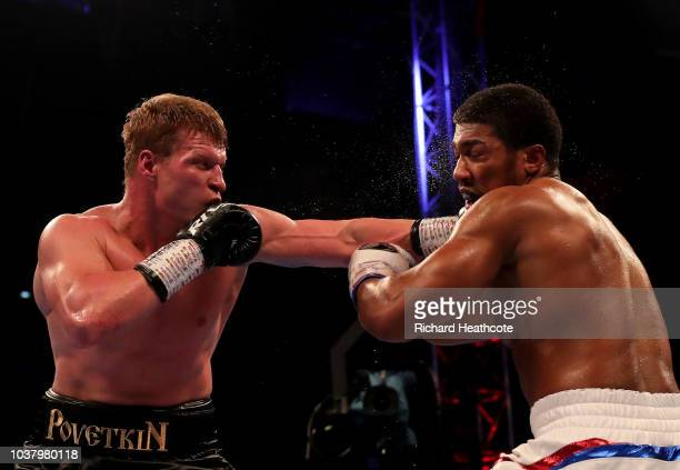 Alexander Povetkin punches Anthony Joshua during the IBF WBA Super WBO IBO World Heavyweight Championship title fight between Anthony Joshua and...