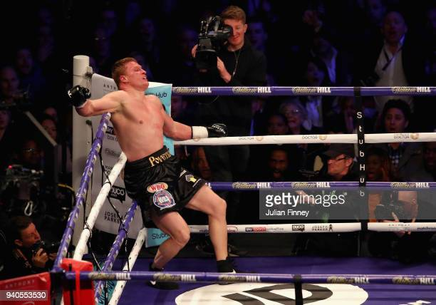 Alexander Povetkin reacts to being punched by David Price during there WBA InterContinental Heavyweight WBO International Heavyweight Championship...