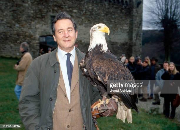Alexander Prince of Sayn Wittgenstein Sayn holding a bald eagle at Bendorf, Germany, 2003.