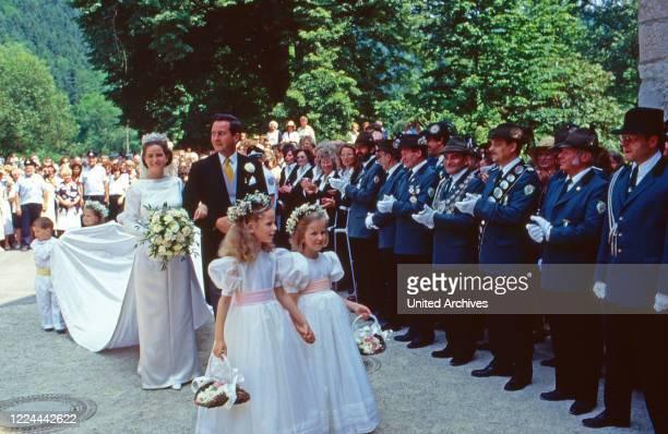Alexander Prince of Sayn Wittgenstein Sayn leading his daughter Princess Alexandra zu Sayn Wittgenstein Sayn to the wedding with Prince Carl Eugen zu...