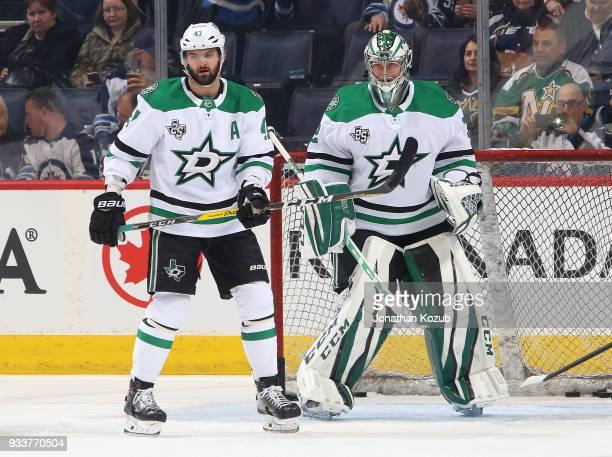 Alexander Radulov and goaltender Kari Lehtonen of the Dallas Stars look on during the pregame warm up prior to NHL action against the Winnipeg Jets...