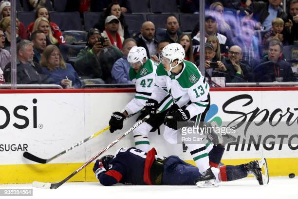 Alexander Radulov and Mattias Janmark of the Dallas Stars go after the puck against Michal Kempny of the Washington Capitals in the first period at...