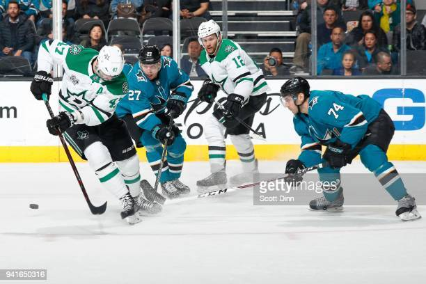 Alexander Radulov and Radek Faksa of the Dallas Stars battle for the puck with Joonas Donskoi and Dylan DeMelo of the San Jose Sharks at SAP Center...