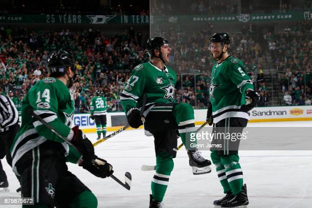 Alexander Radulov Jamie Oleksiak and Jamie Benn of the Dallas Stars celebrate a goal against the Edmonton Oilers at the American Airlines Center on...