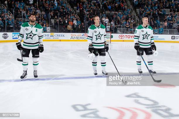 Alexander Radulov John Klingberg and Ersa Lindell of the Dallas Stars stand for the national anthem of the game against the San Jose Sharks at SAP...