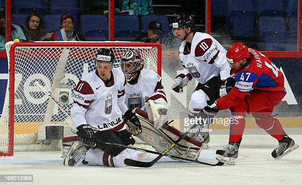 Alexander Radulov of Russia and Kristaps Sotnieks of Latvia battle for the puck during the IIHF World Championship group H match between Russia and...