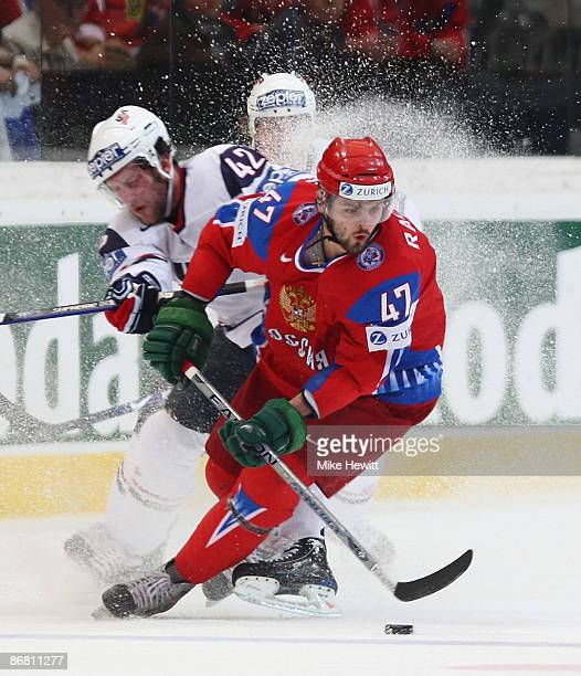 Alexander Radulov of Russia is challenged by David Backes of USA during the IIHF World Championship Semi-Final between USA and Russia at the...