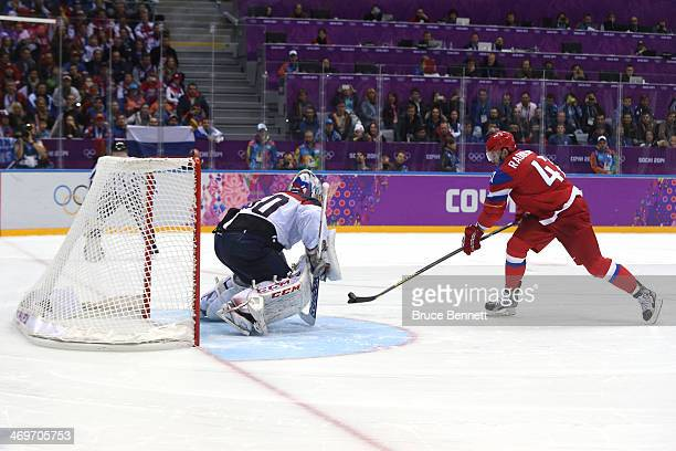 Alexander Radulov of Russia scores a goal in the shoot out against Jan Laco of Slovakia during the Men's Ice Hockey Preliminary Round Group A game on...