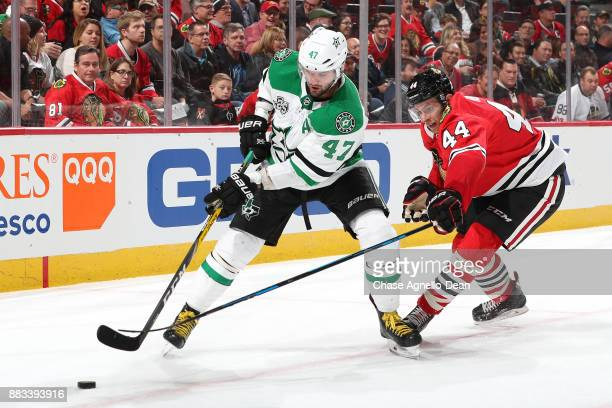 Alexander Radulov of the Dallas Stars and Jan Rutta of the Chicago Blackhawks battle for the puck in the third period at the United Center on...