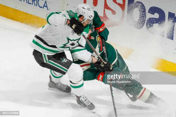 Alexander Radulov of the Dallas Stars and Matt Dumba of the Minnesota Wild skate to the puck during the game at the Xcel Energy Center on March 29...