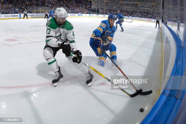 Alexander Radulov of the Dallas Stars and Ryan O'Reilly of the St Louis Blues battle for the puck at Enterprise Center on March 2 2019 in St Louis...