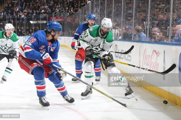 Alexander Radulov of the Dallas Stars battles for possession against Marc Staal of the New York Rangers at Madison Square Garden on December 11 2017...