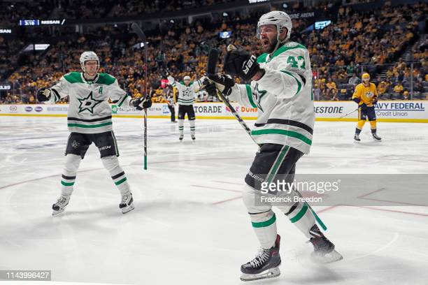 Alexander Radulov of the Dallas Stars celebrates with teammate John Klingberg after scoring a goal against the Nashville Predators during the second...