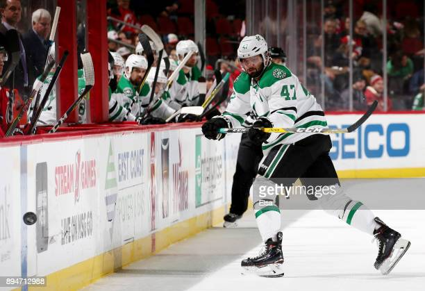 Alexander Radulov of the Dallas Stars clears the puck in the first period against the New Jersey Devils on December 15 2017 at Prudential Center in...
