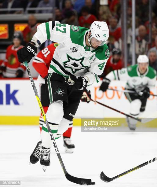 Alexander Radulov of the Dallas Stars controls the puck against the Chicago Blackhawks at the United Center on February 8 2018 in Chicago Illinois...
