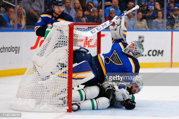 Alexander Radulov of the Dallas Stars crashes into Jordan Binnington of the St Louis Blues after taking a shot on goal in Game Seven of the Western...