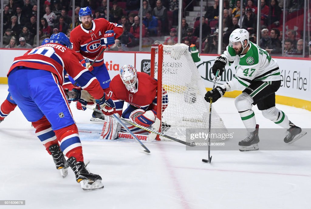 Alexander Radulov #47 of the Dallas Stars looks to pass the puck against the Montreal Canadiens, on his 300th NHL game, at the Bell Centre on March 13, 2018 in Montreal, Quebec, Canada.