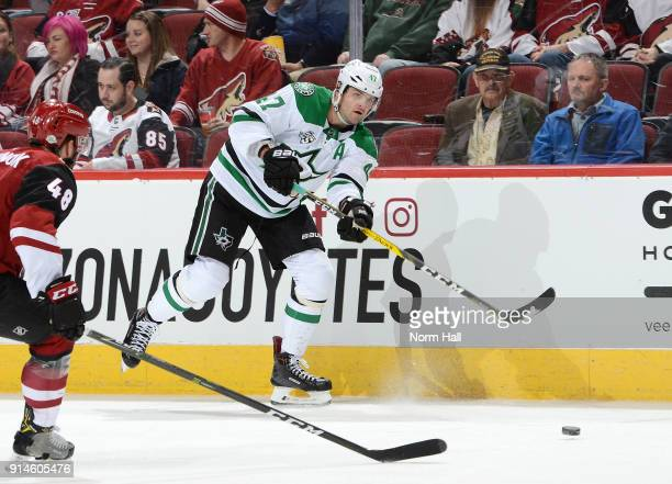Alexander Radulov of the Dallas Stars passes the puck against the Arizona Coyotes at Gila River Arena on February 1 2018 in Glendale Arizona