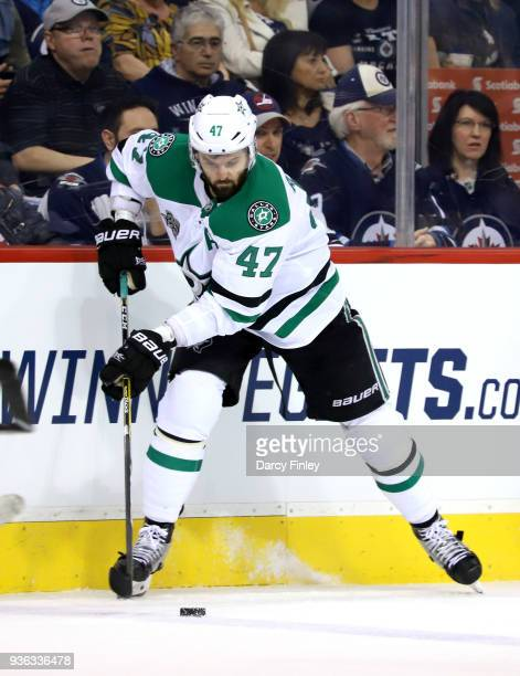 Alexander Radulov of the Dallas Stars plays the puck along the boards during second period action against the Winnipeg Jets at the Bell MTS Place on...
