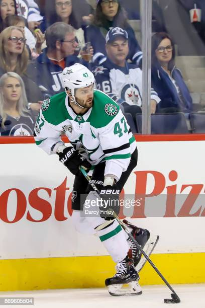 Alexander Radulov of the Dallas Stars plays the puck down the ice during third period action against the Winnipeg Jets at the Bell MTS Place on...
