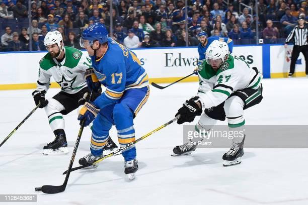 Alexander Radulov of the Dallas Stars pressures Jaden Schwartz of the St Louis Blues at Enterprise Center on March 2 2019 in St Louis Missouri