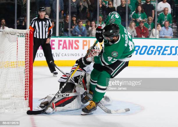 Alexander Radulov of the Dallas Stars scores a shootout goal against Anton Forsberg of the Chicago Blackhawks at the American Airlines Center on...