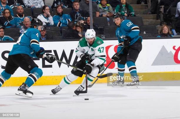Alexander Radulov of the Dallas Stars skates with the puck against Brenden Dillon of the San Jose Sharks at SAP Center on April 3 2018 in San Jose...