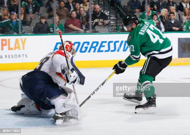 Alexander Radulov of the Dallas Stars slips in a goal against Harri Sateri of the Florida Panthers at the American Airlines Center on January 23 2018...