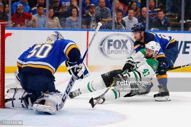 Alexander Radulov of the Dallas Stars takes a shot on goal against Vince Dunn and Jordan Binnington of the St Louis Blues in Game Seven of the...