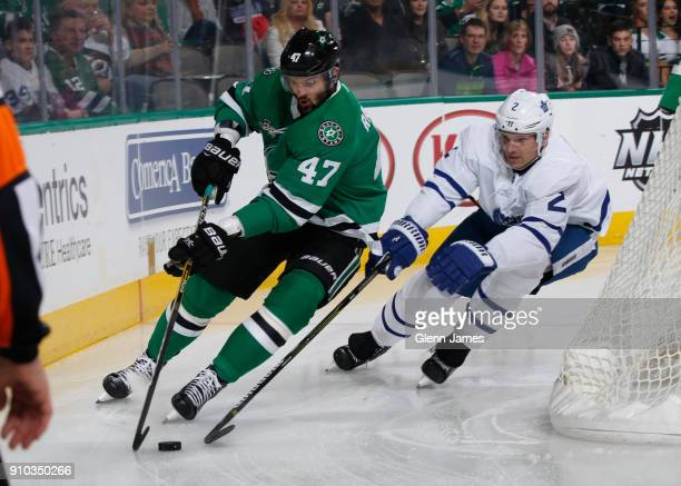 Alexander Radulov of the Dallas Stars tries to keep the puck away against Ron Hainsey of the Toronto Maple Leafs at the American Airlines Center on...
