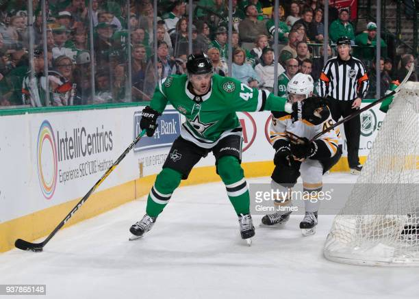 Alexander Radulov of the Dallas Stars tries to keep the puck away against Matt Grzelcyk of the Boston Bruins at the American Airlines Center on March...