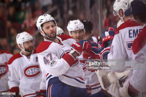 Alexander Radulov of the Montreal Canadiens celebrates with teammates on the bench after scoring a goal against the Arizona Coyotes during the third...