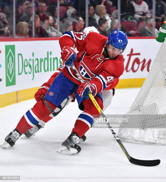 Alexander Radulov of the Montreal Canadiens controls the puck against the Detroit Red Wings in the NHL game at the Bell Centre on March 21 2017 in...