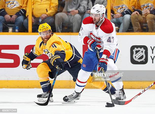 Alexander Radulov of the Montreal Canadiens skates against Ryan Ellis of the Nashville Predators during an NHL game at Bridgestone Arena on January 3...