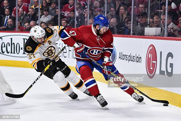 Alexander Radulov of the Montreal Canadiens skates the puck against Patrice Bergeron of the Boston Bruins during the NHL game at the Bell Centre on...