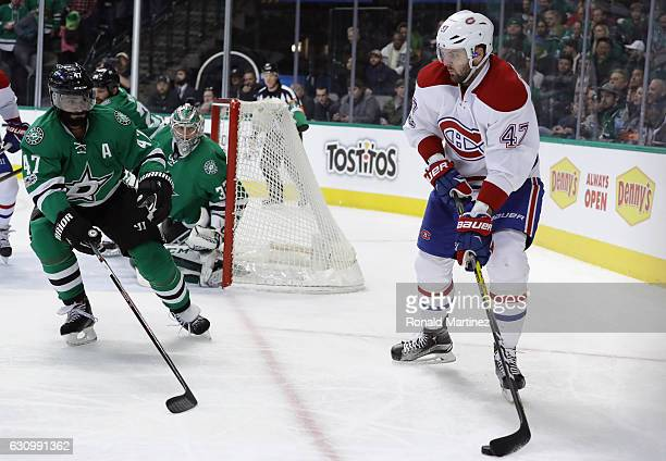 Alexander Radulov of the Montreal Canadiens skates the puck against Johnny Oduya of the Dallas Stars at American Airlines Center on January 4 2017 in...