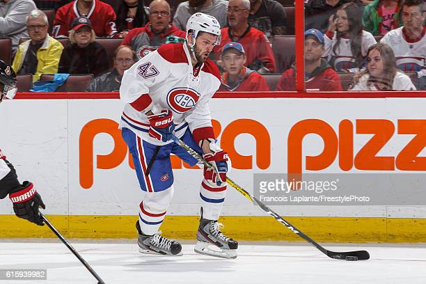 Alexander Radulov of the Montreal Canadiens skates with the puck against the Ottawa Senators in an NHL game at Canadian Tire Centre on October 15...