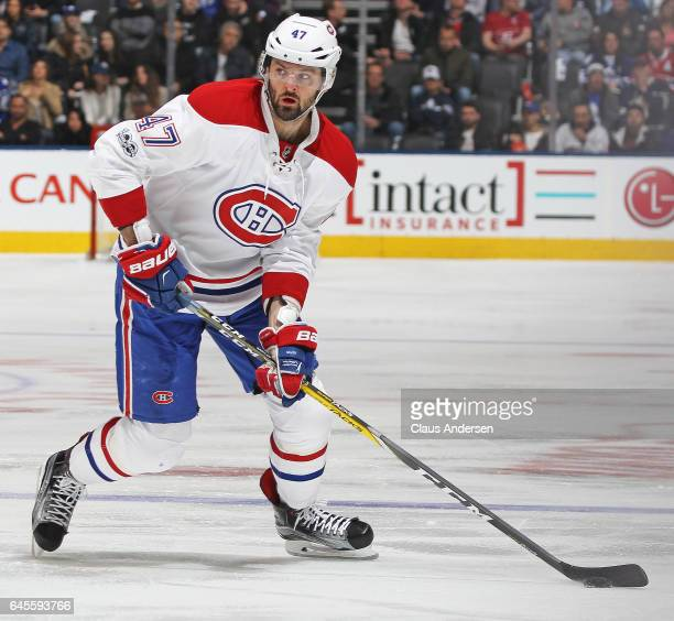 Alexander Radulov of the Montreal Canadiens skates with the puck against the Toronto Maple Leafs during an NHL game at the Air Canada Centre on...